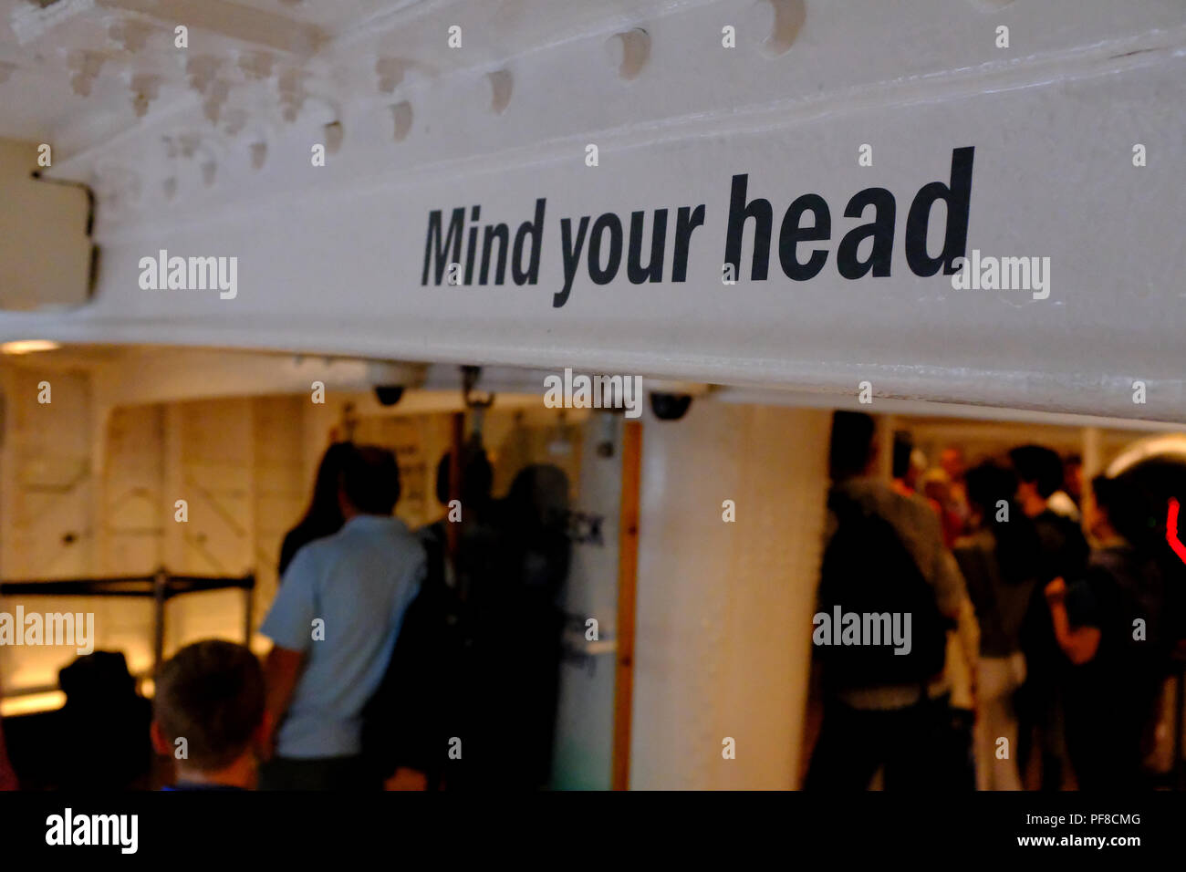 'Mind your head' sign inside The Cutty Sark at Greenwich London UK - Stock Image