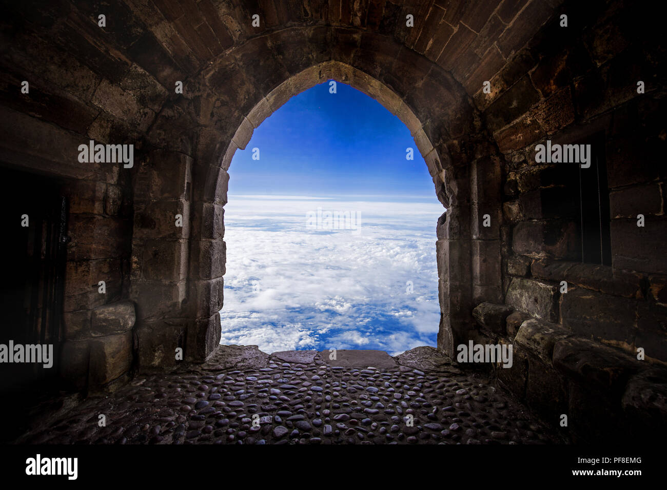 The door open to the world from old place or cave.Let us explore the world, Taking risk, open your vision, get out of cormfort zone concepts. Stock Ph Stock Photo