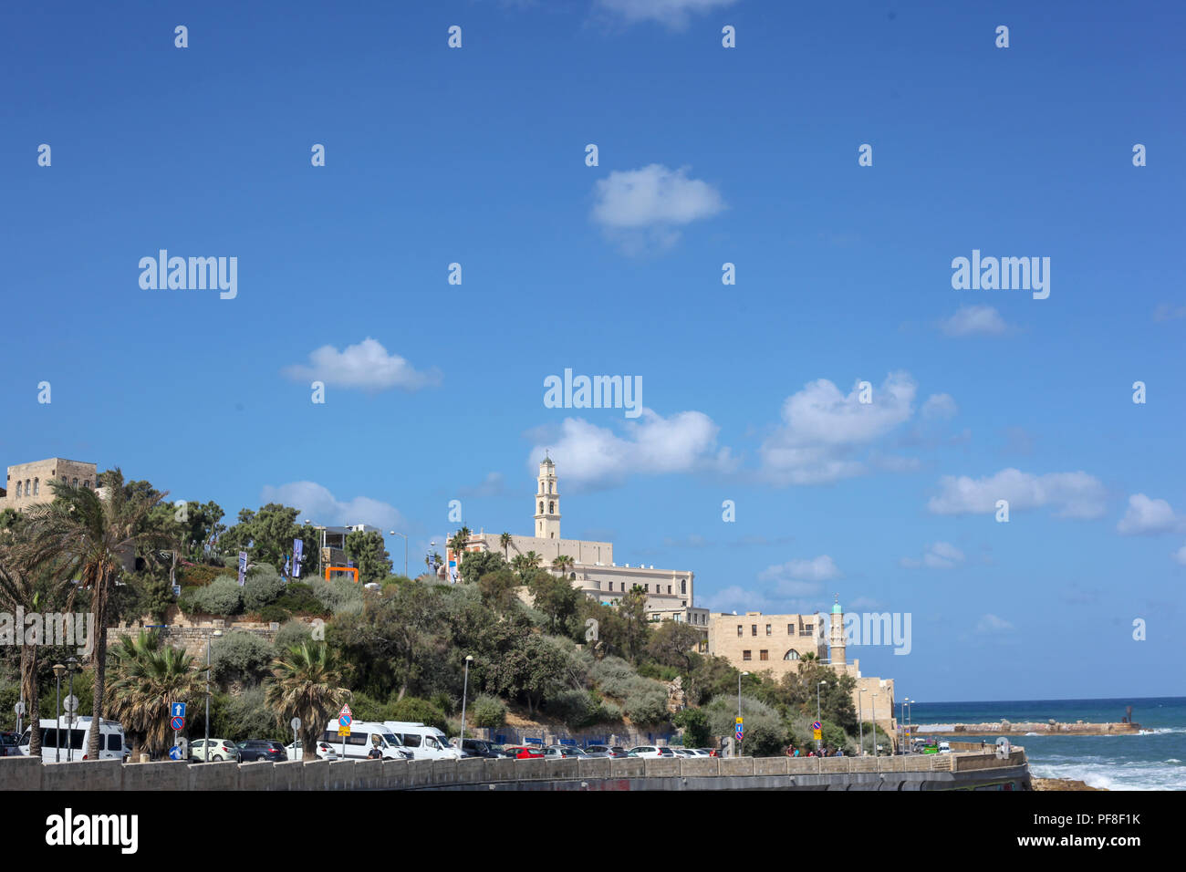 Israel, Old Jaffa as seen from the North.  The entrance to the acient port on the right and the belfry of the Church and Monastery of St Peter in the  Stock Photo