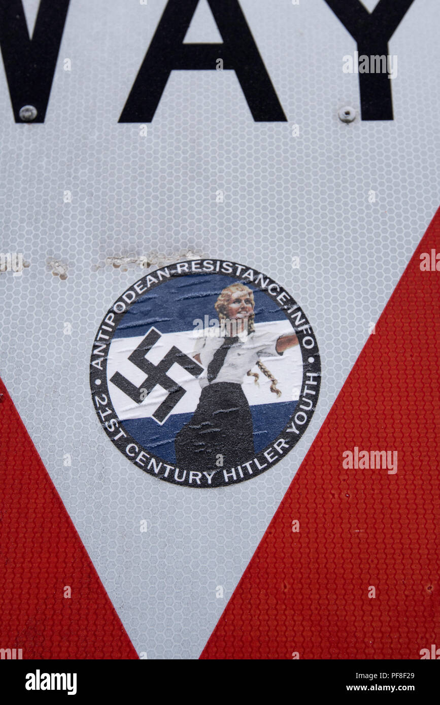 A White supremacy movement sticker or decal stuck to a Give Way road sign in Bathurst, New South Wales, Australia - Stock Image