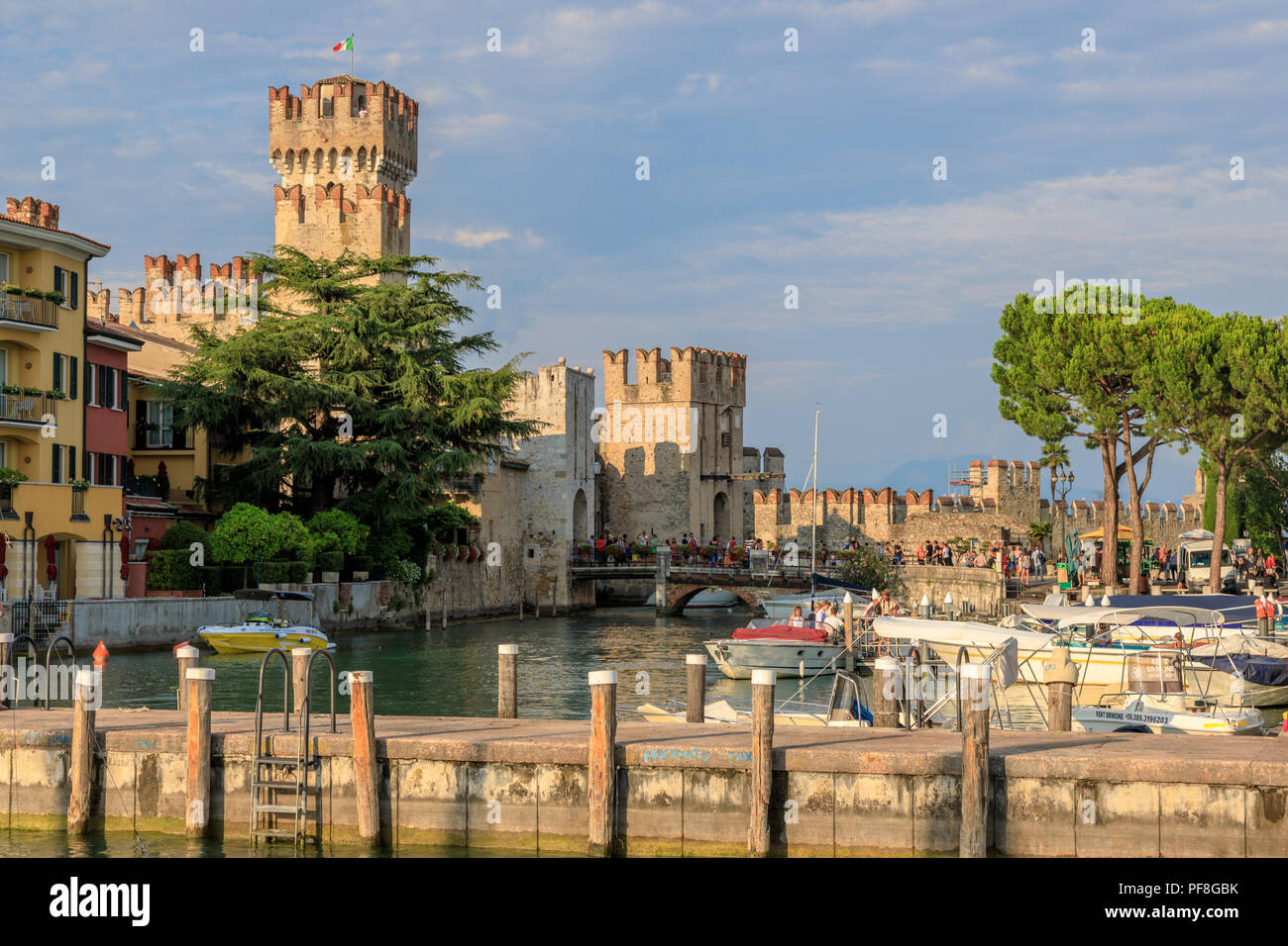The harbour and castle of Sirmione a medieval town and tourist destination on Lake Garda in the Italian Lakes region - Stock Image