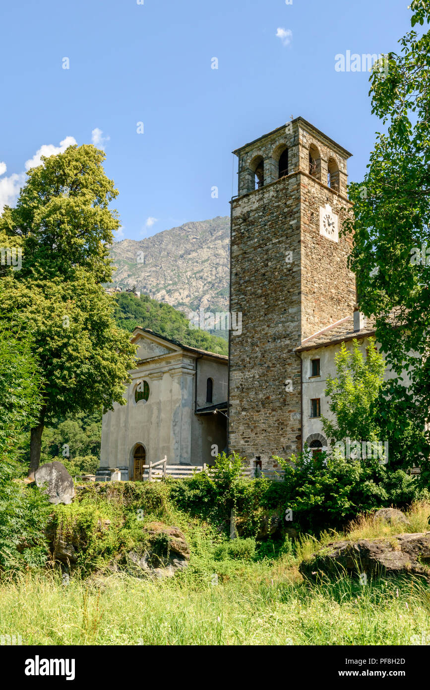 view of medieval castle stone tower of Hereres, nowdays bell tower of parrish church, shot on a bright summer day at Perloz,  Lys valley, Aosta, Italy - Stock Image