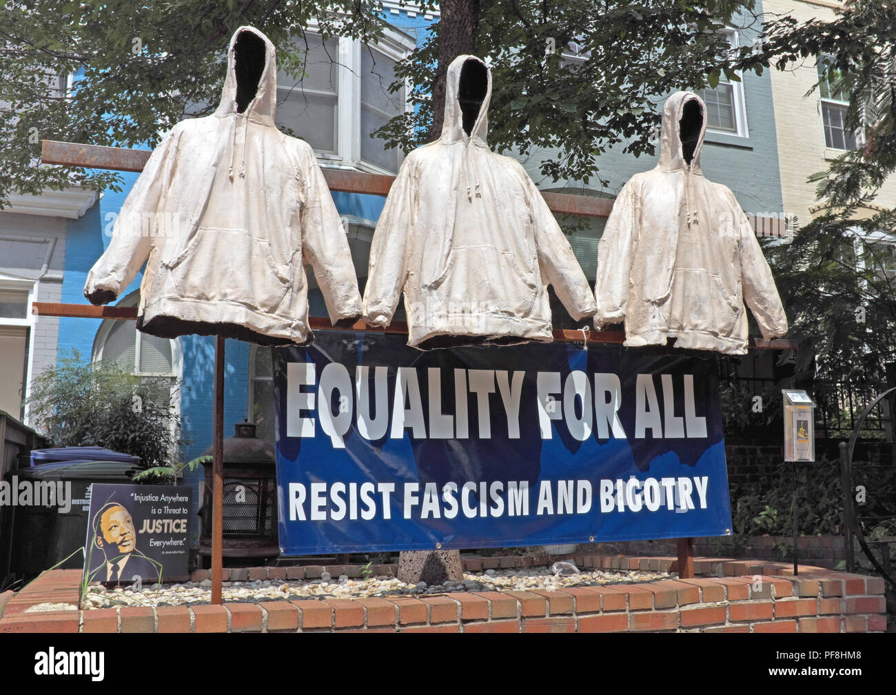 In the Foggy Bottom neighborhood of Washington D.C., a statement is made 'Equality for All Resist Fascism and Bigotry' with 3 white jacket dummies. - Stock Image