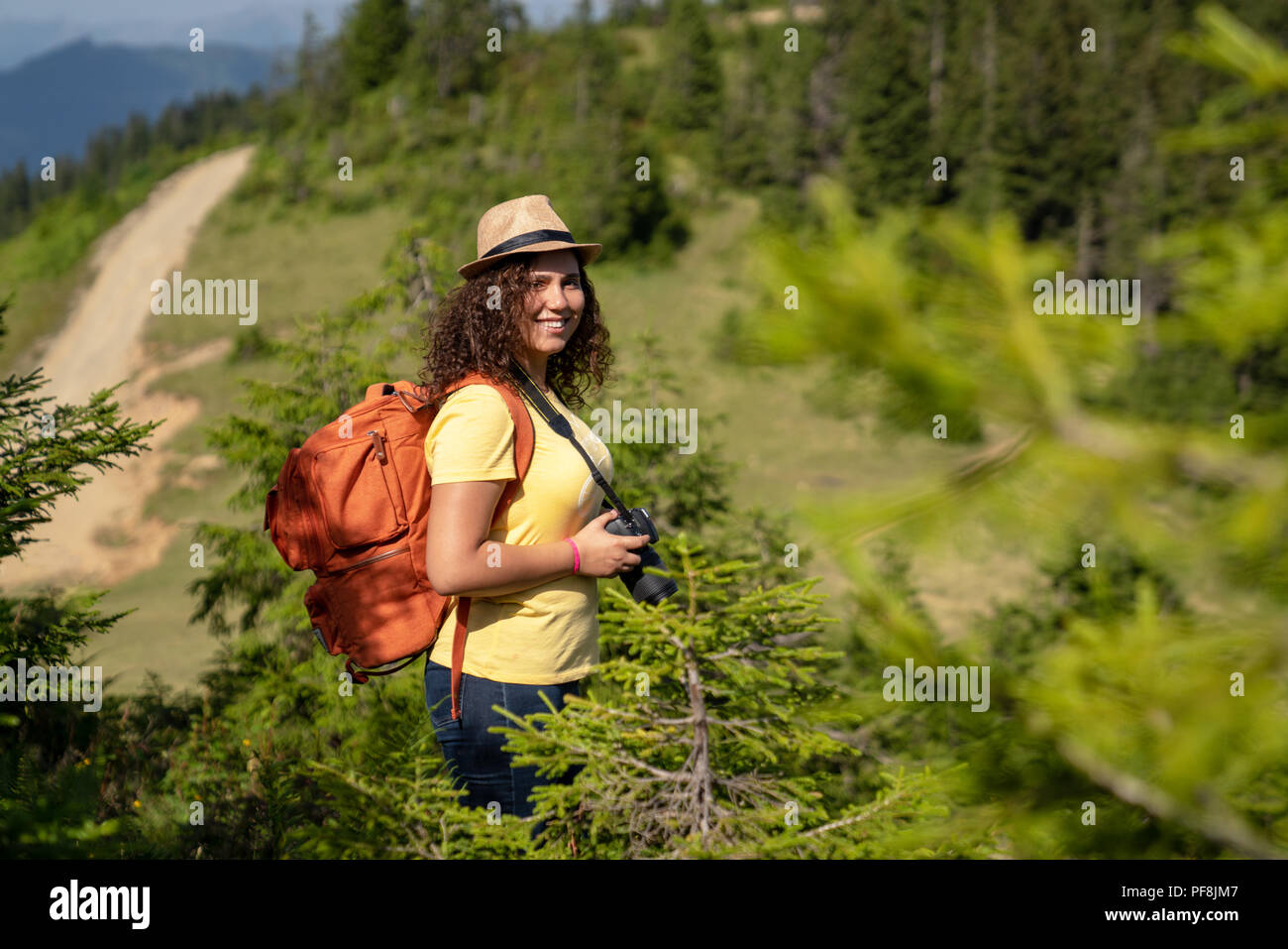 Young tourist woman taking a photo of landscape. Stock Photo