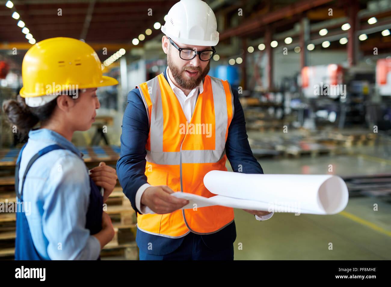 Engineer Holding Blueprints Stock Photo