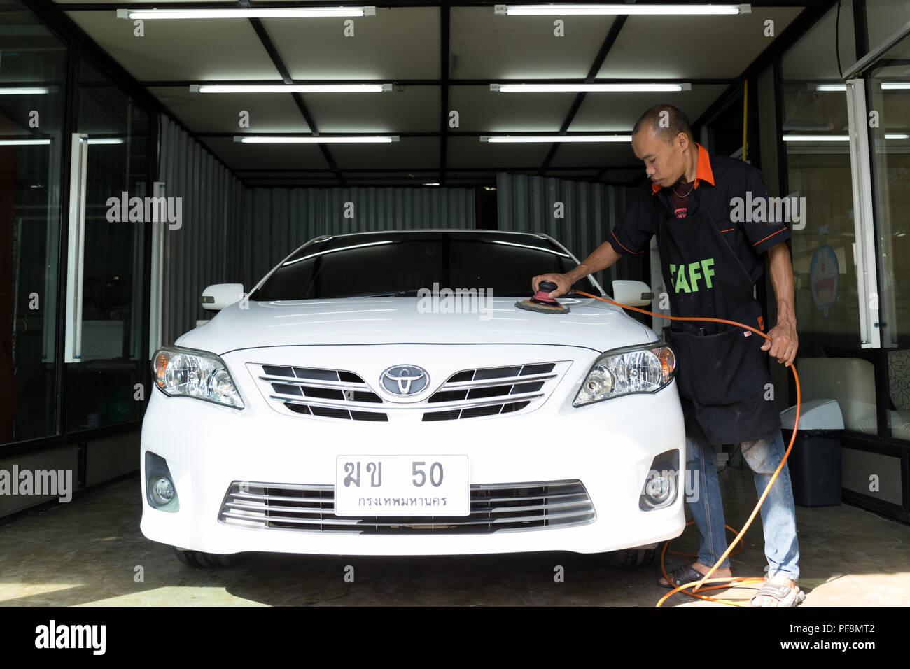 Jan, 28, 60 - At Nong carwash, Bangkok Thailand - Logo TOYOTA on a car , staff worker hand polishing car wash in car wash. - Stock Image