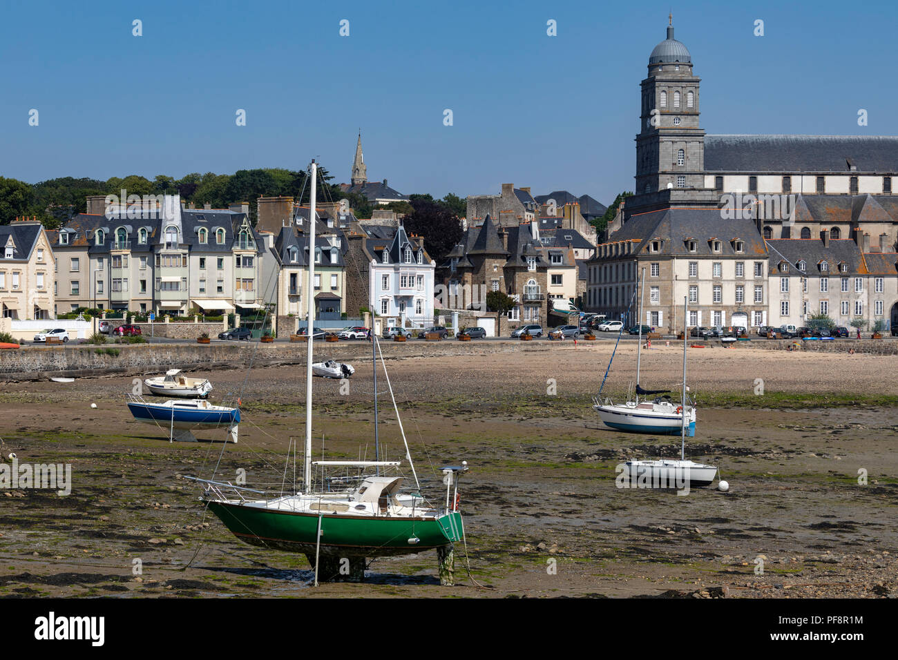 Low tide at the Solidor waterfront in the port of Saint Malo on the north coast of Brittany in France - Stock Image