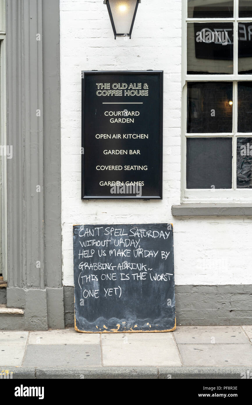 Pub chalk board outside leaning against wall with nonsense message - Stock Image