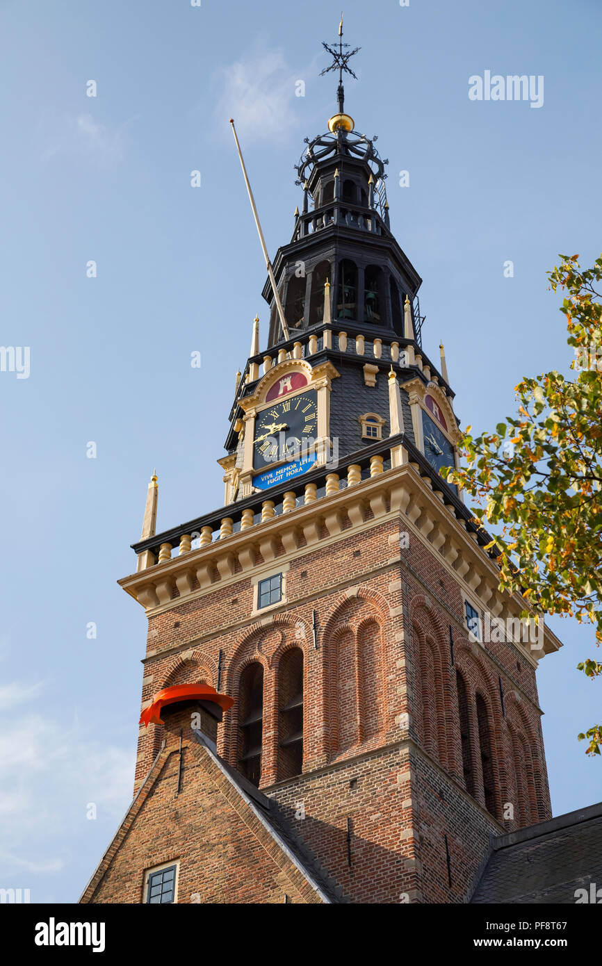 Alkmaar, Netherlands - July 20, 2018: Tower of the Waag building, weighing-house, with a red hat as a sign that the cheese market will start - Stock Image