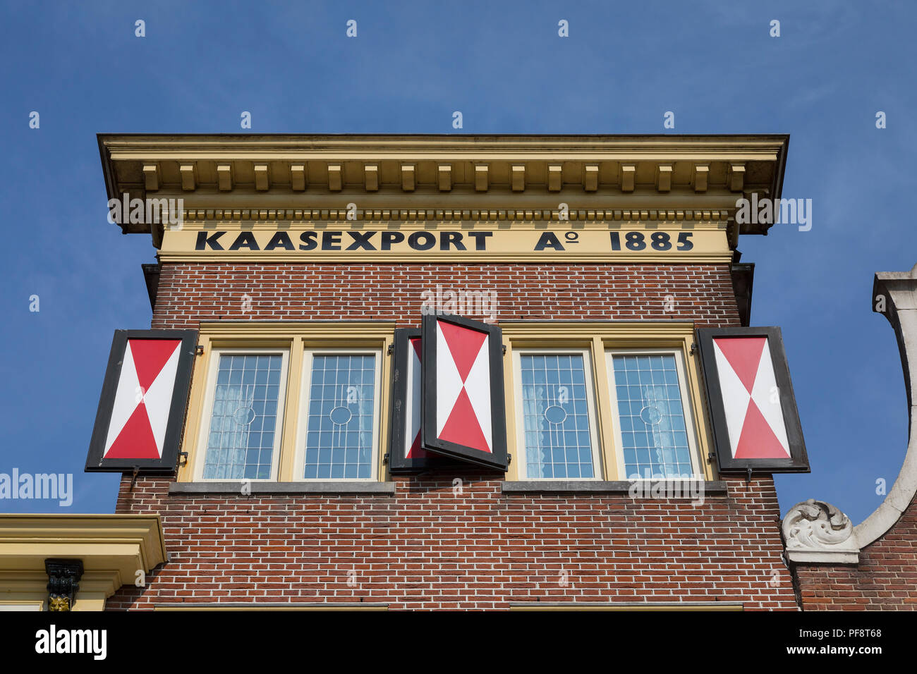 Alkmaar, Netherlands - July 20, 2018: Facade of a building with the sign cheese export and is built in 1885 near the cheese market - Stock Image