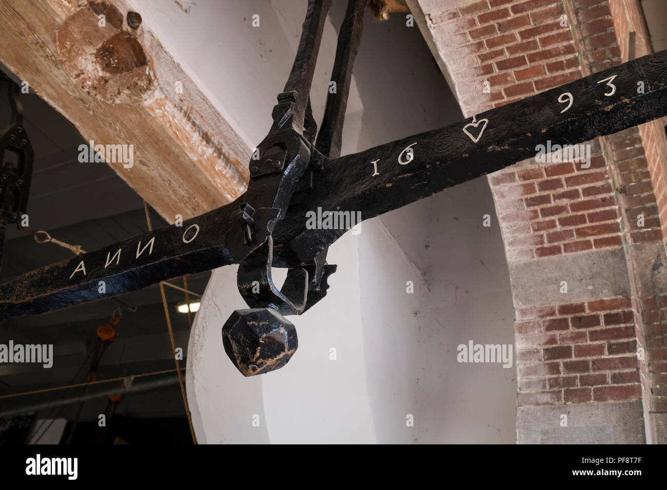 Alkmaar, Netherlands - July 20, 2018: Antique cheese scale in the Waag buiding on the cheese market in Alkmaar  dated 1693 - Stock Image