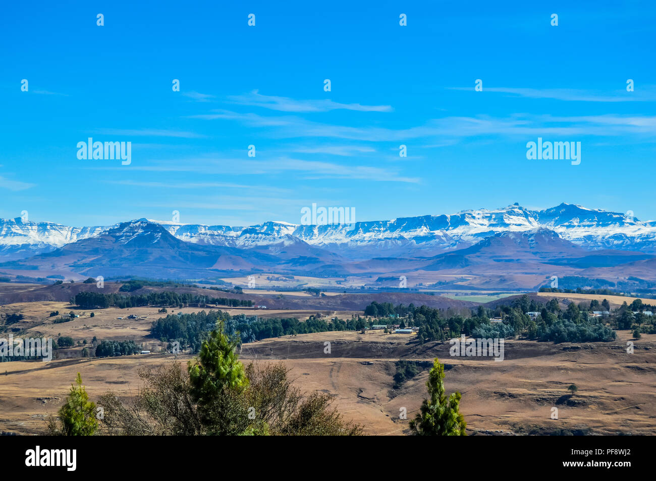 Landscape of Underberg , a small countryside village with snow clad drakensberg mountains and green landscapes - Stock Image