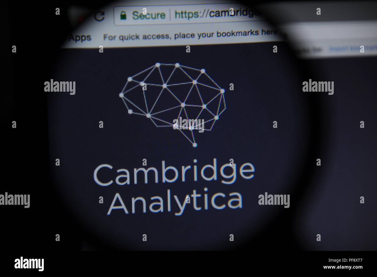 The Cambridge Analytica website website seen through a magnifying glass - Stock Image