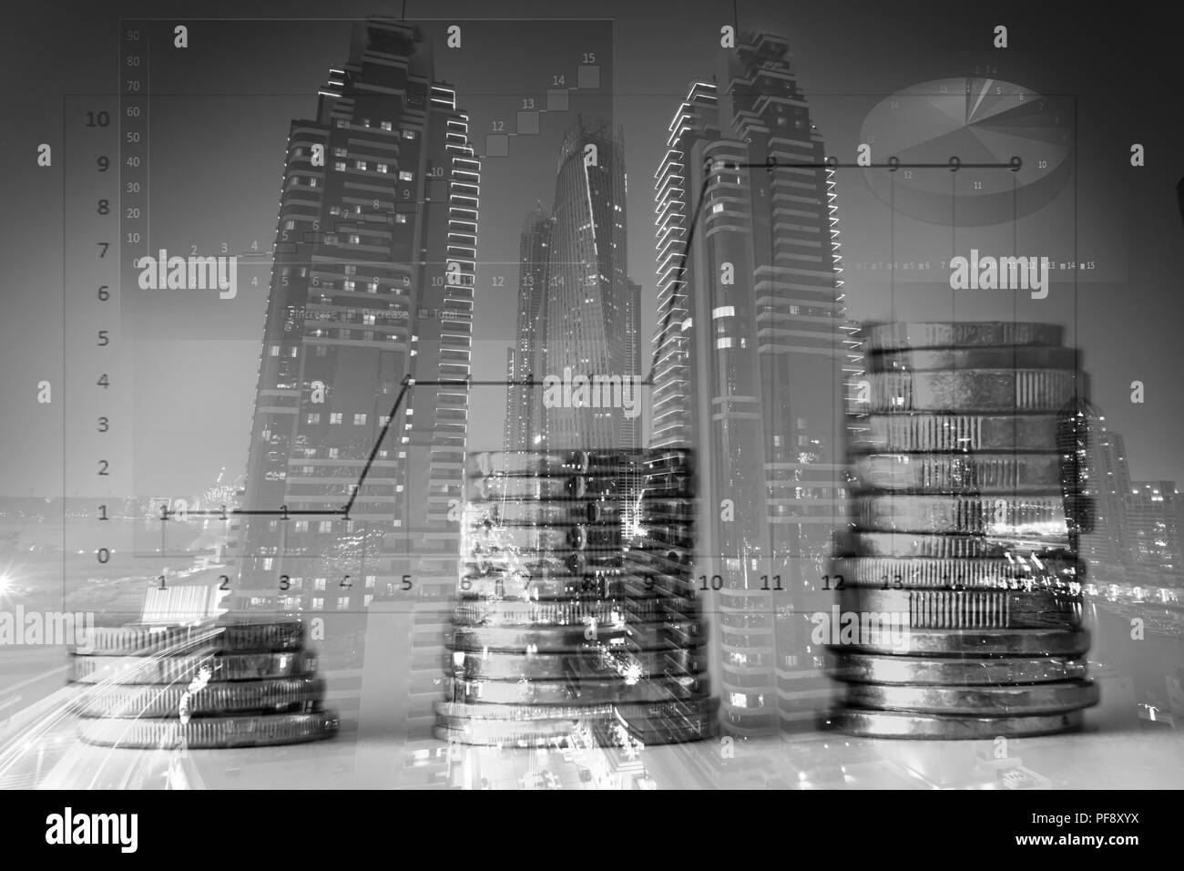 Stacked coins with a city background double exposre - Stock Image