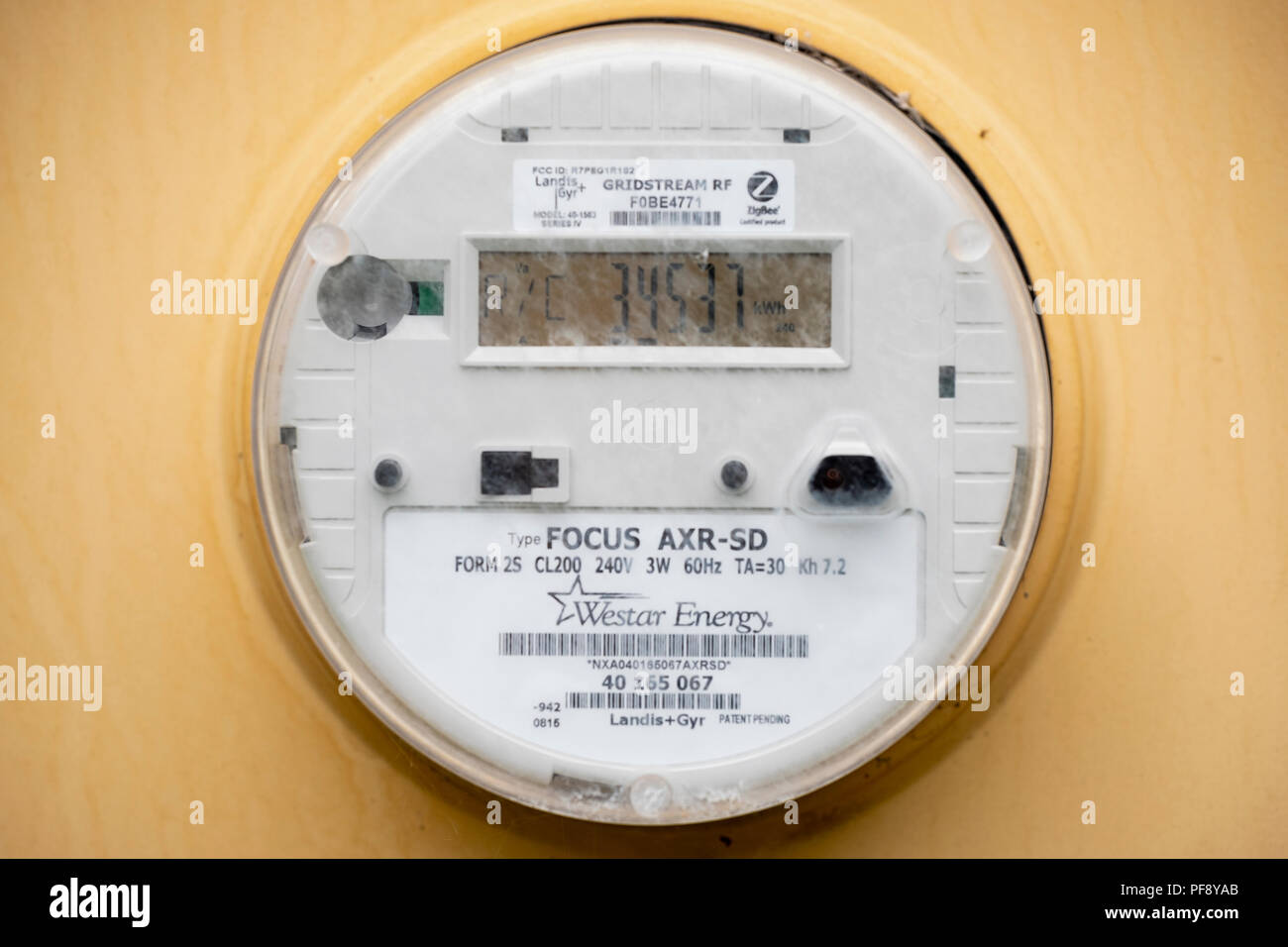 An electrical measuring meter measuring electrical usage of a home in Wichita, Kansas, USA. - Stock Image