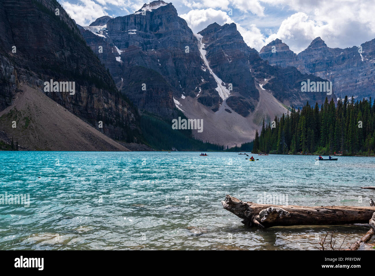 Banff, Canada--August 6, 2018.  Wide angle shot boaters on Moraine Lake on a sunny summer afternoon. - Stock Image