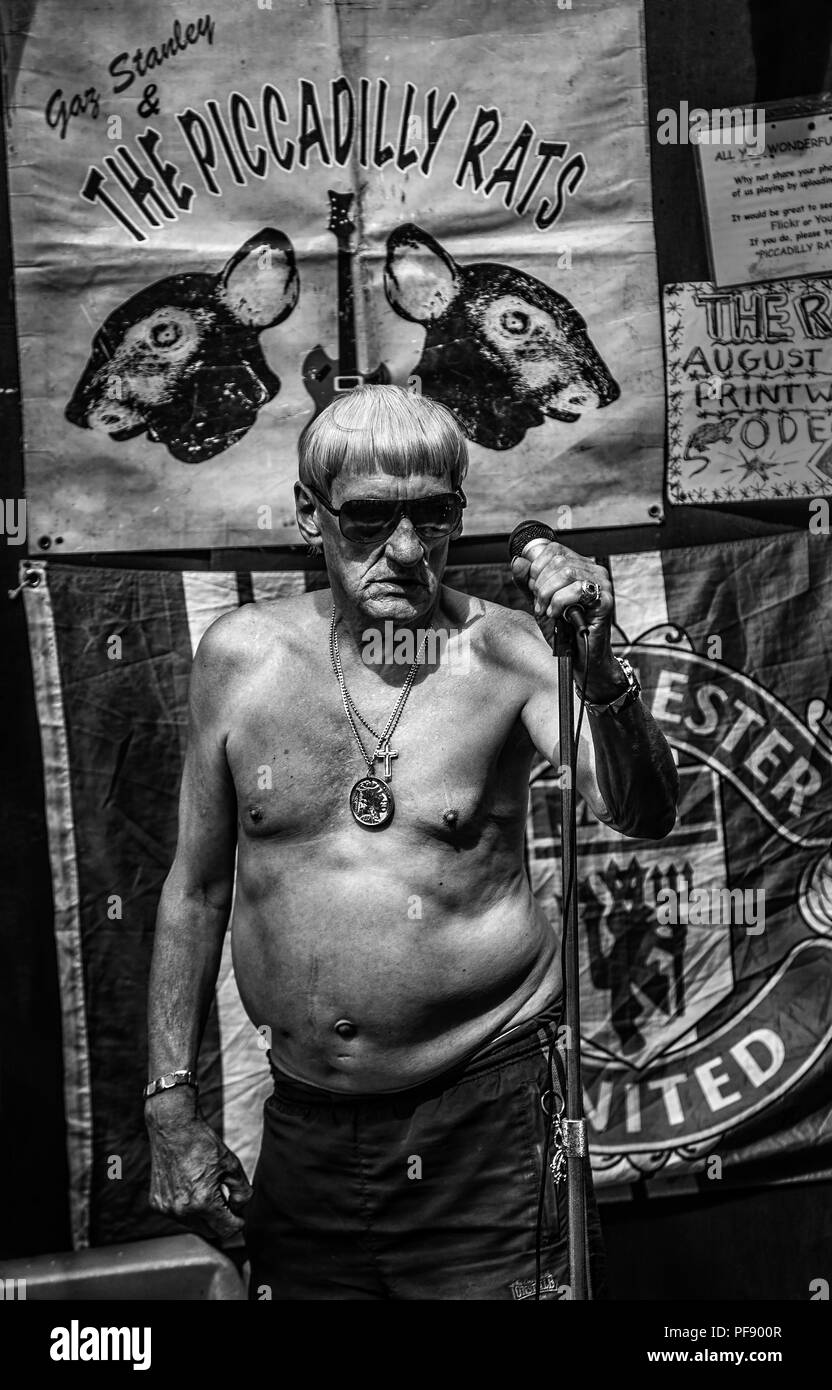 Frontman Of Street Performers The Piccadilly Rats Band In Manchester City Centre, England, UK - Stock Image