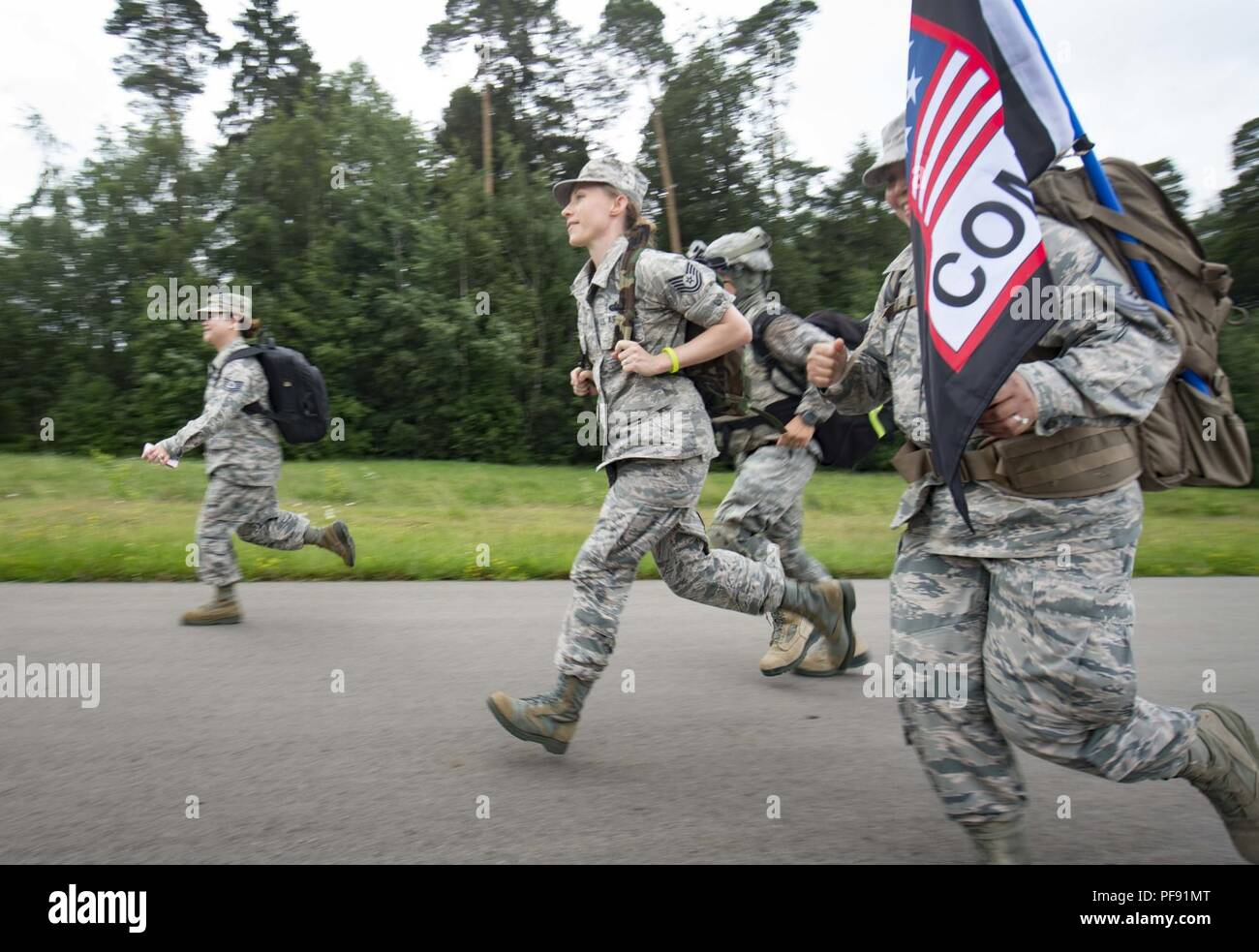 US Airmen Assigned To The 1st Combat Communications Squadron Run During Third Annual Chief Master