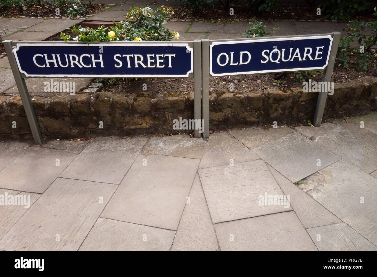 Merging roads and two Church street, Old Street road name signs in the busy market town of Warwick, Warwickshire - Stock Image