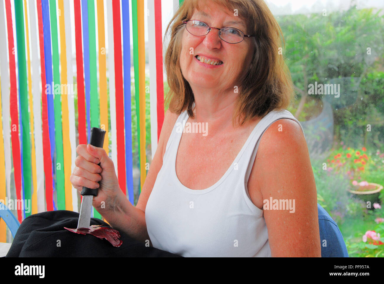 Fortuneswell. 19th August 2018. Sandra, 64, makes a prop knife to go on a costume for her local 'Am-dram' group's upcoming production of Norman Robbin - Stock Image
