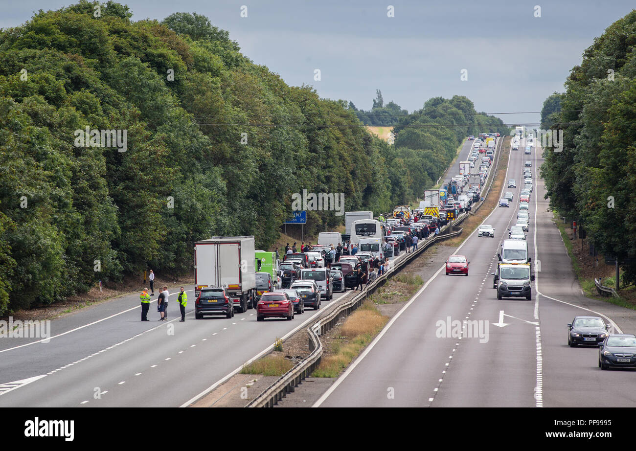 Motorway closed with queuing traffic and people out of their cars on A1 motorway, junction 7 southbound in Hertfordshire - Stock Image