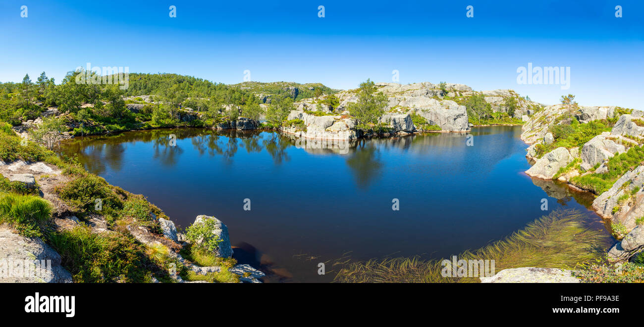 Lake on the footpath to Preikestolen cliff, Lysefjord, Norway - Stock Image