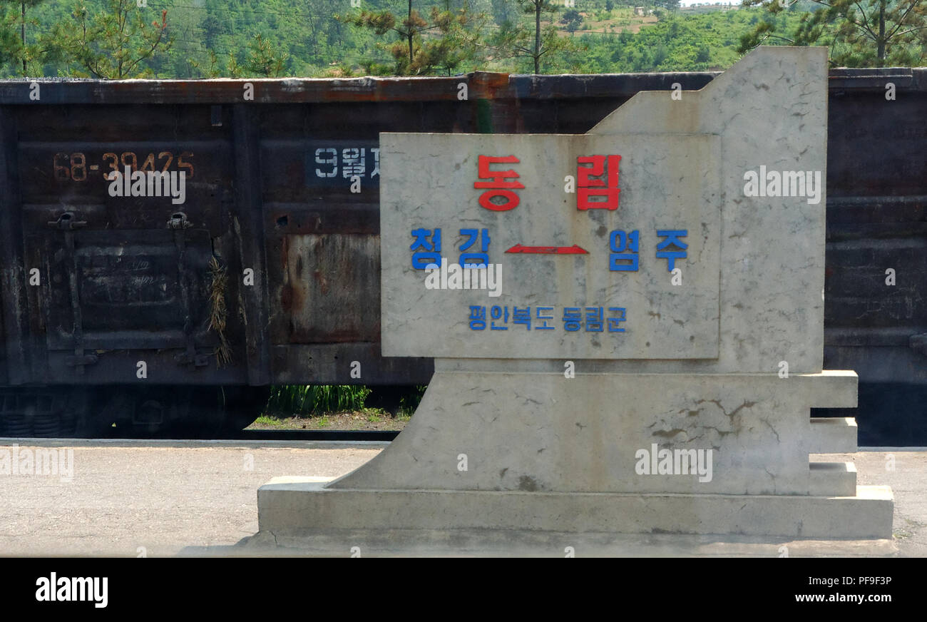 Portraits of Kim Ll-sung and Kim Jong-Il adorn every train railway station in North Korea. Often with quotes of their wisdom alongside them. - Stock Image