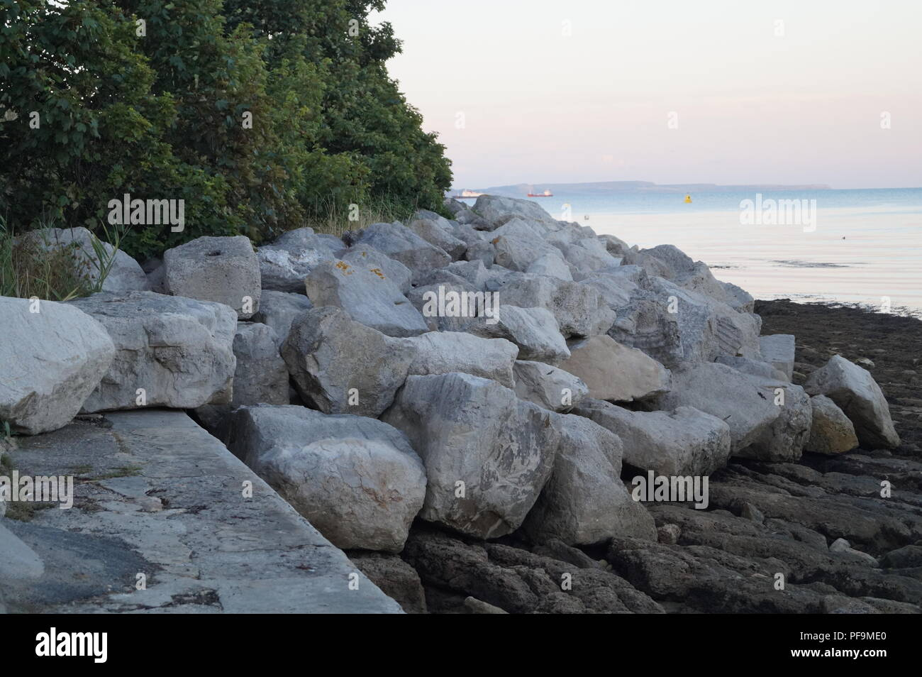 part of the breakwater at newtons cove in Weymouth Stock Photo