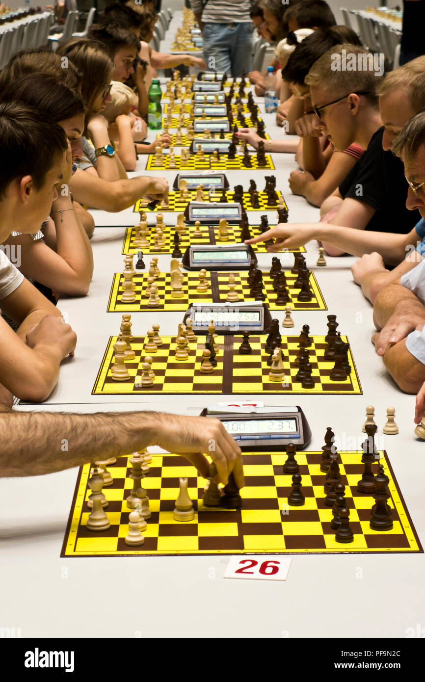 row of chess players during a tournament - Stock Image