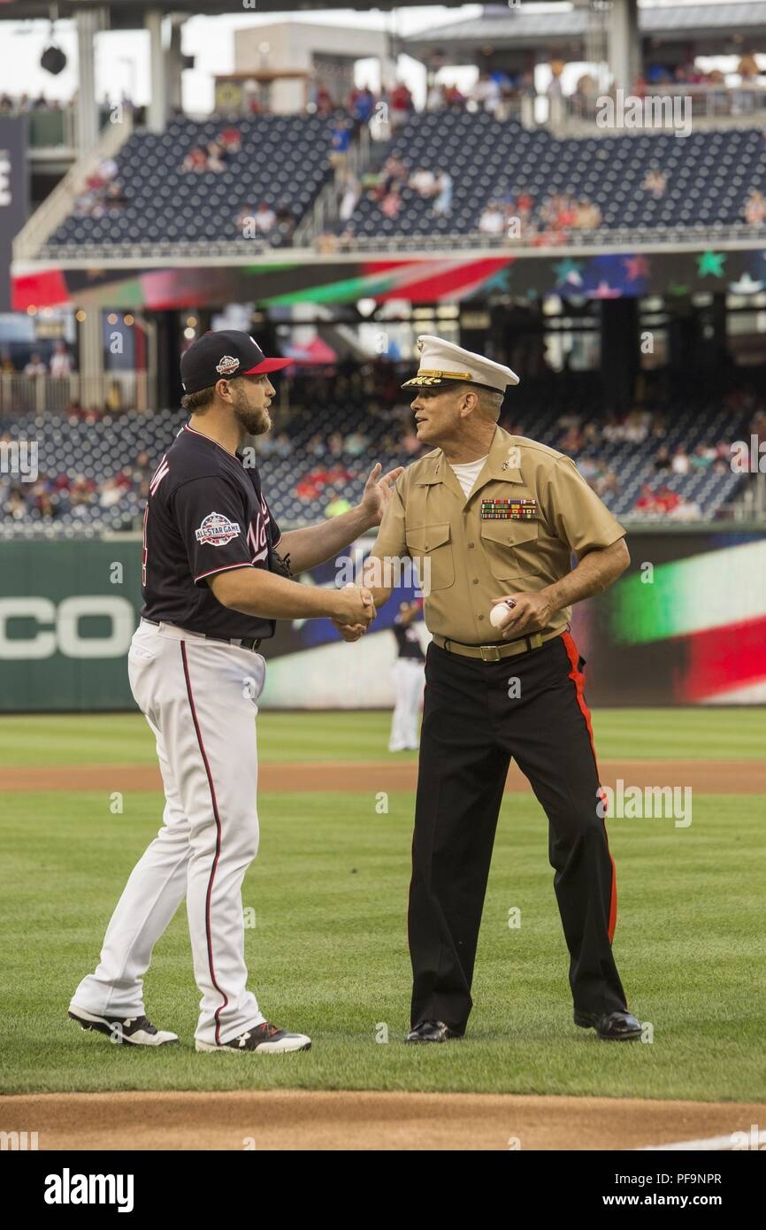 Major Gen John R Ewers Jr, staff judge advocate to the Commandant of the Marine Corps, shakes the hand of Washington Nationals catcher, Spencer Kieboom, during US Marine Corps Day at Nationals Park, Washington DC, July 31, 2018. Image courtesy Sgt. Robert Knapp/Marine Barracks Washington, 8th. () Stock Photo
