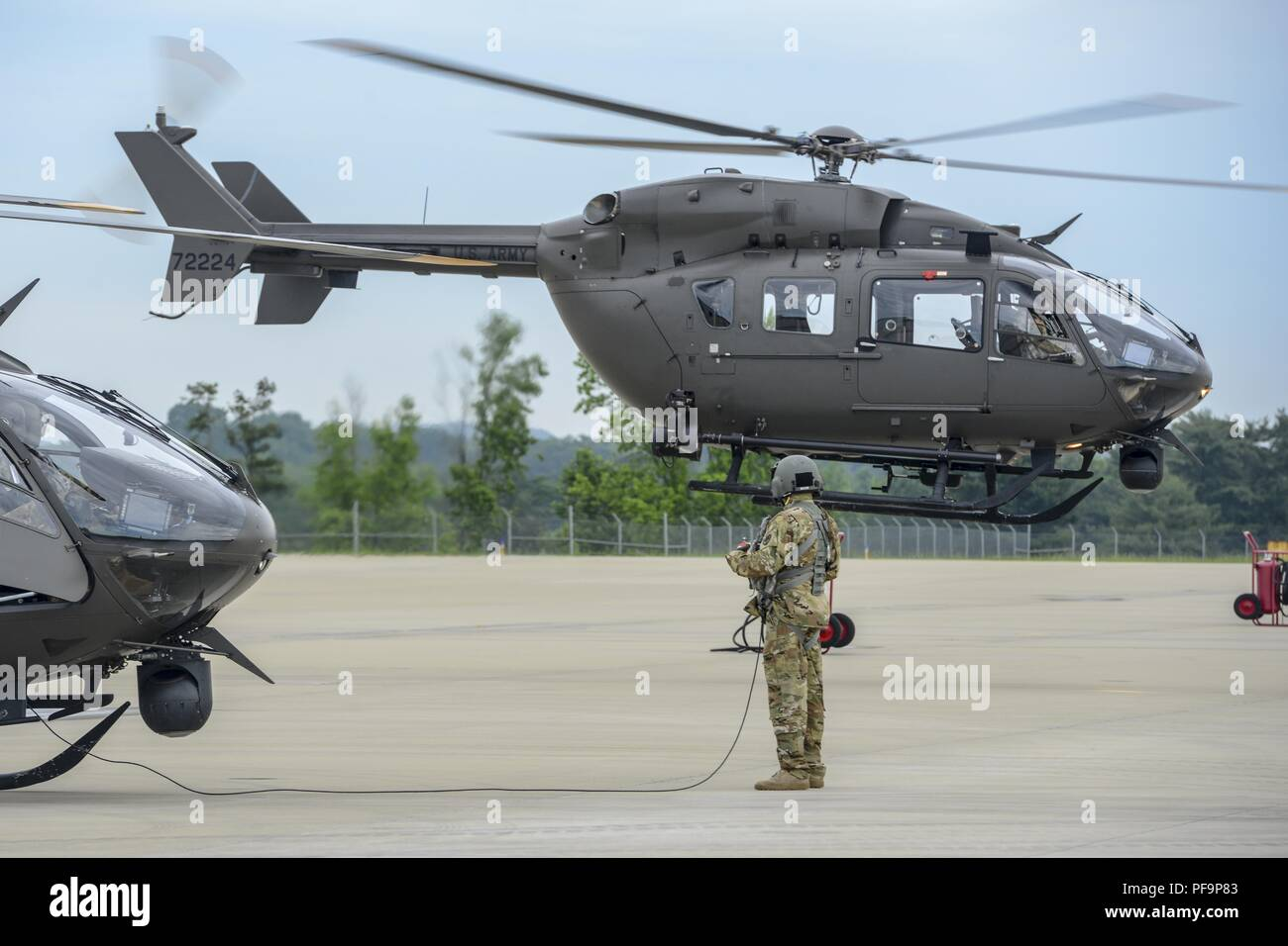 US Soldiers assigned to the 2-151st Security and Support Aviation Battalion, South Carolina Army National Guard depart the SC Technology and Aviation Center, Greenville, SC in a UH-72A Lakota helicopter to provide support to the US Border Patrol in Texas, May 21, 2018. Image courtesy Sgt. Jorge Intriago/South Carolina National Guard. () Stock Photo