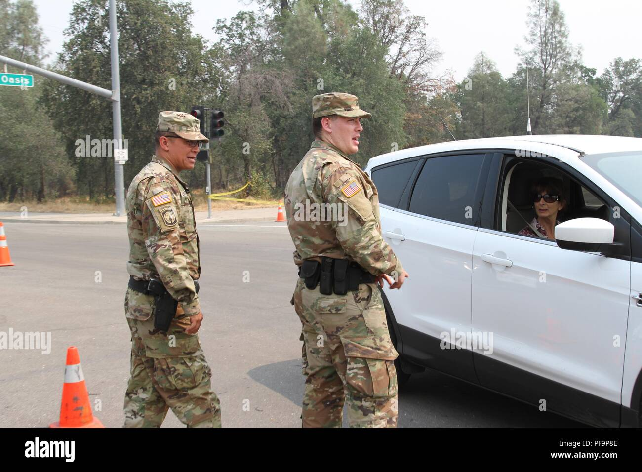 Military police from the California Army National Guard supported law enforcement late July in Redding, California, after the Carr Fire erupted and destroyed 500 structures and torched nearly 50, 000 acres within a week, July 29, 2018. Image courtesy Staff Sgt. Edward Siguenza/California National Guard. () - Stock Image