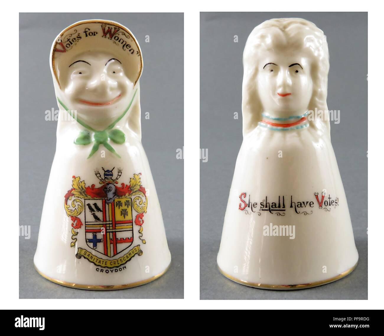 Two-sided china bells, featuring an image of a female suffragist as both harridan and lovely woman, sold as souvenirs in vacation spots in England, United Kingdom, with merchants from each area adding the crest of their town (such as Croyden's here) to the piece, 1920. () - Stock Image