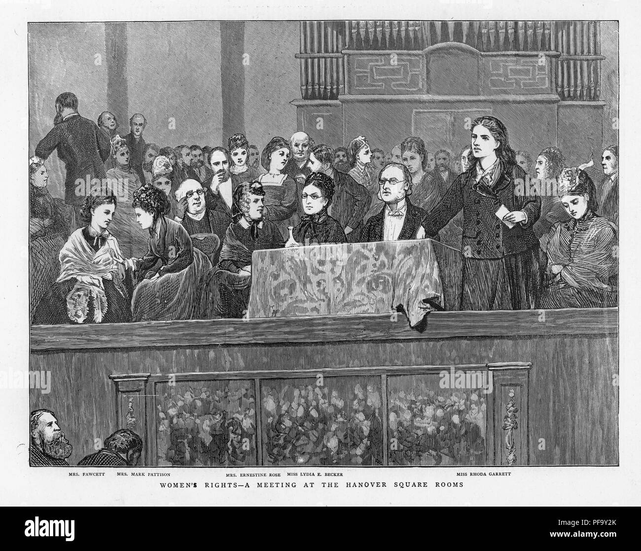Black and white print illustrating English suffragists Lydia Becker, Dame Millicent Garrett Fawcett, Mrs Mark Patison (aka Emilia Dilke), Mrs Ernestine Rose, and Rhoda Garrett, along with male supporters, demanding rights during a meeting at the Hanover Square Rooms, published for the British market, 1872. () - Stock Image