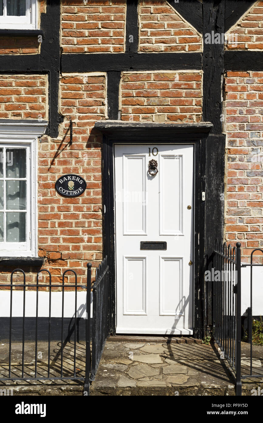 Winslow, UK - April 27, 2015. Traditional Georgian front door on a Tudor cottage in the historic market town of Winslow, Buckinghamshire - Stock Image