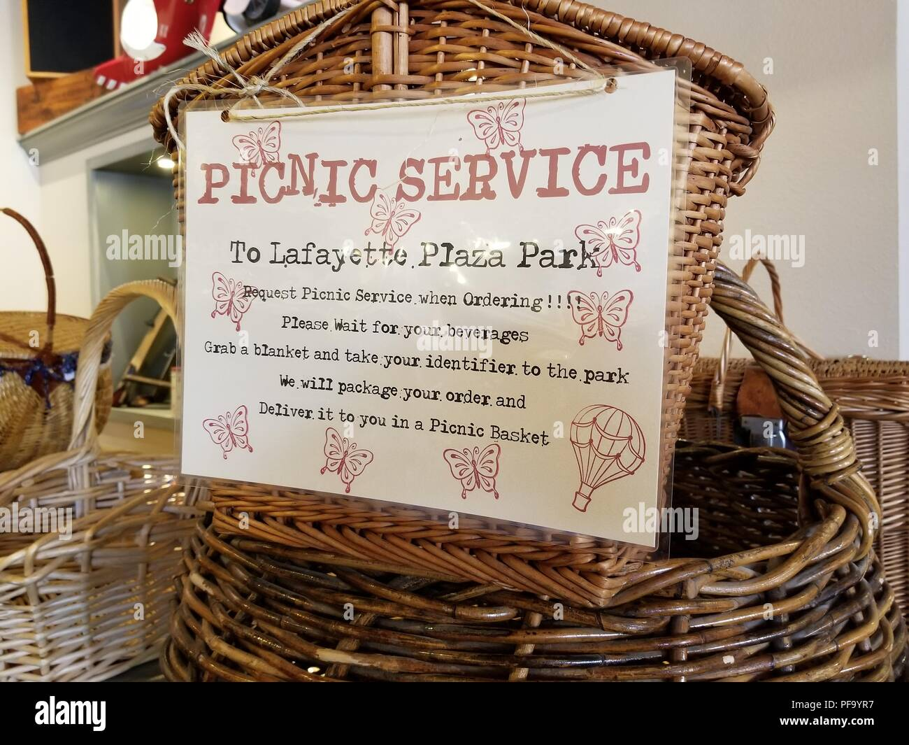 Advertisement for picnic basket service to a local public park at the trendy Sideboard restaurant in Lafayette, California, June 28, 2018. () - Stock Image