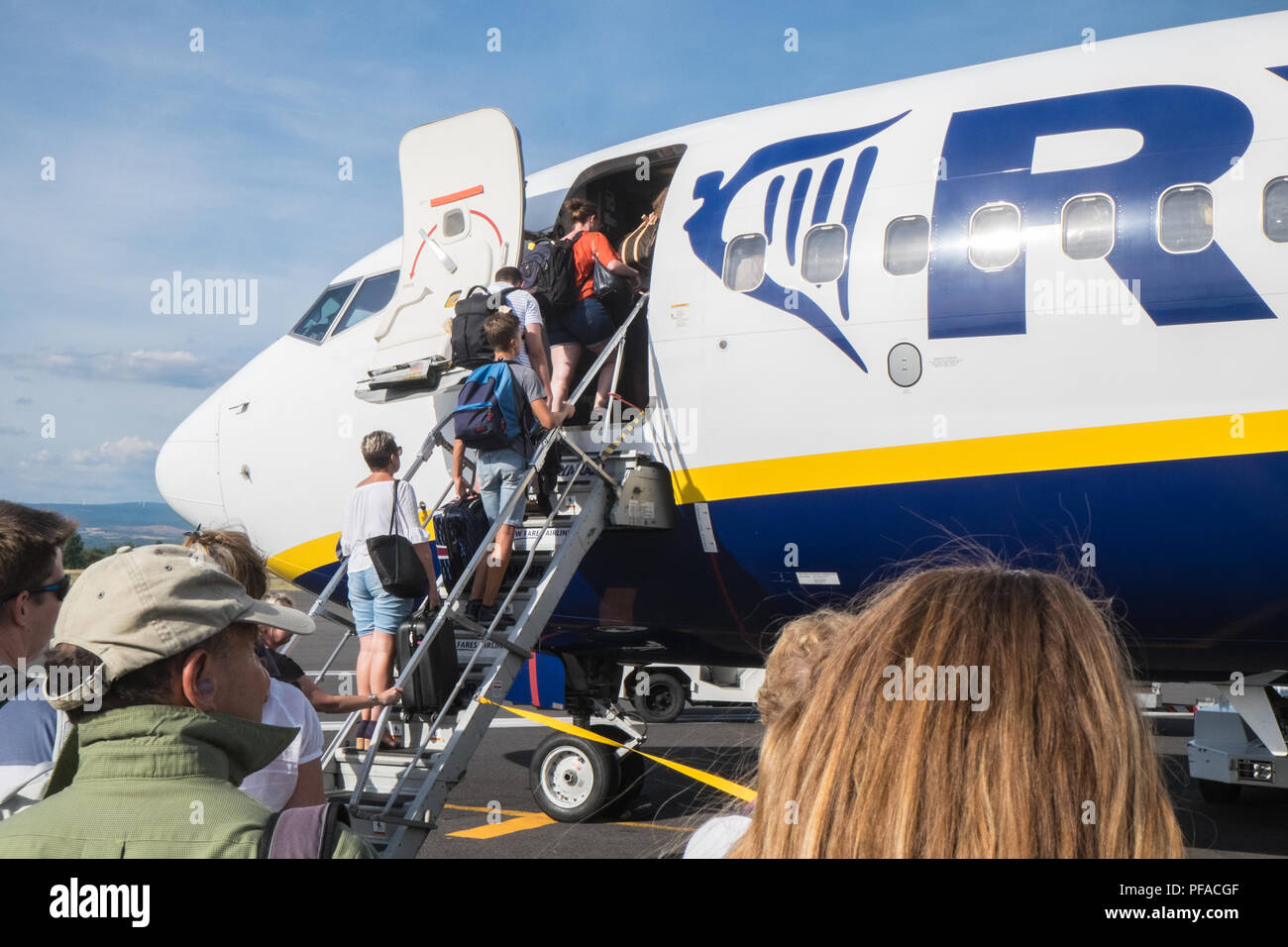 Passengers,travellers,boarding,Ryanair,Boeing,on,tarmac,at,Carcassonne,Airport,South,of,France,.Flight,to Stansted Airport,London,England,Europe, Stock Photo