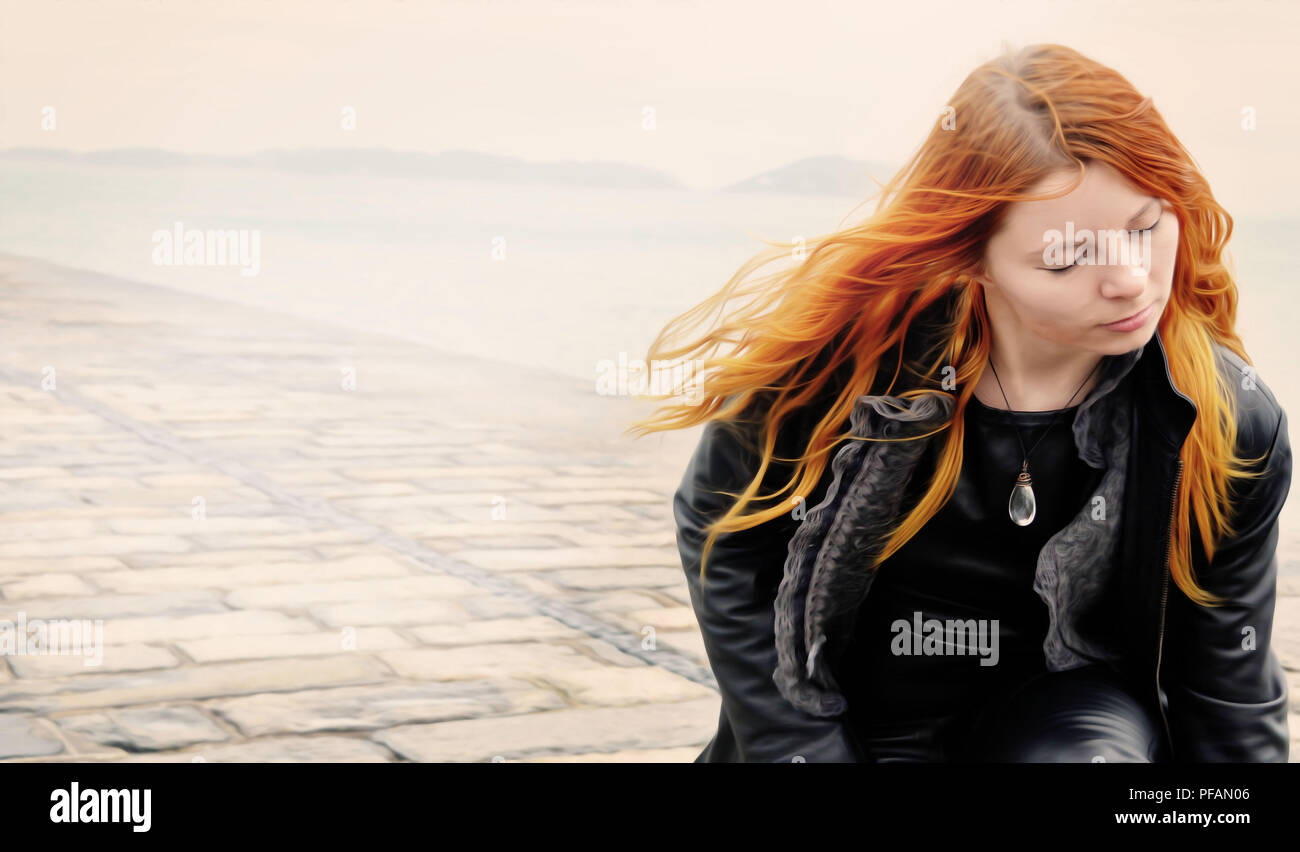 Ginger girl and wind - Stock Image