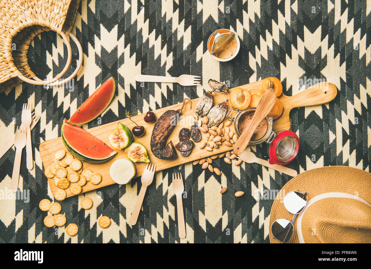 Picnic concept with sausage, fruit, nuts, cheese and pate - Stock Image