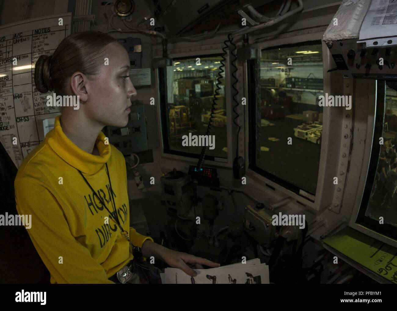 5th FLEET AREA OF OPERATIONS (June 7, 2018) Aviation Boatswain's Mate (Handling) Airman Joley Vessell stands Conflag Station 7 watch in hangar deck control aboard the Wasp-class amphibious assault ship USS Iwo Jima (LHD 7), June 7, 2018. Iwo Jima, homeported in Mayport, Fla., is on deployment to the U.S. 5th Fleet area of operations in support of maritime security operations to reassure allies and partners, and preserve the freedom of navigation and the free flow of commerce in the region. Stock Photo