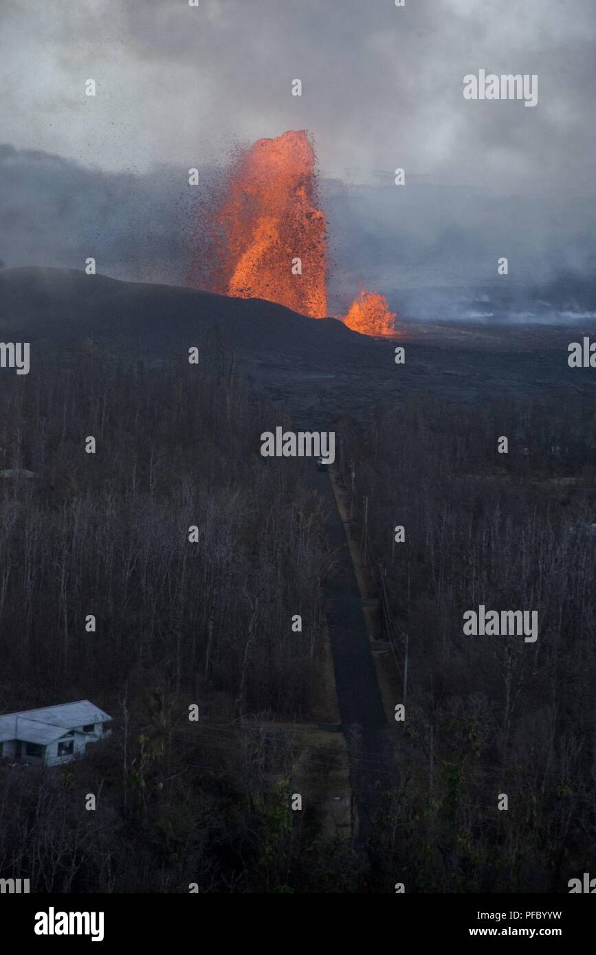 Leilani Estates, Hawaii, May 30, 2018 – Lava continues to fountain at Fissure 8, reaching heights of 130-210 feet. This activity is feeding a lava channel flowing east to the Kapoho Bay area as lava continues to enter the ocean around the Vacationland subdivision area. Volcanic gas emissions remain very high from the fissure eruptions. At the request of the state, FEMA staff are on the ground to support local officials with life-saving emergency protective measures, debris removal, and the repair, replacement, or restoration of disaster-damaged publicly-owned facilities. - Stock Image