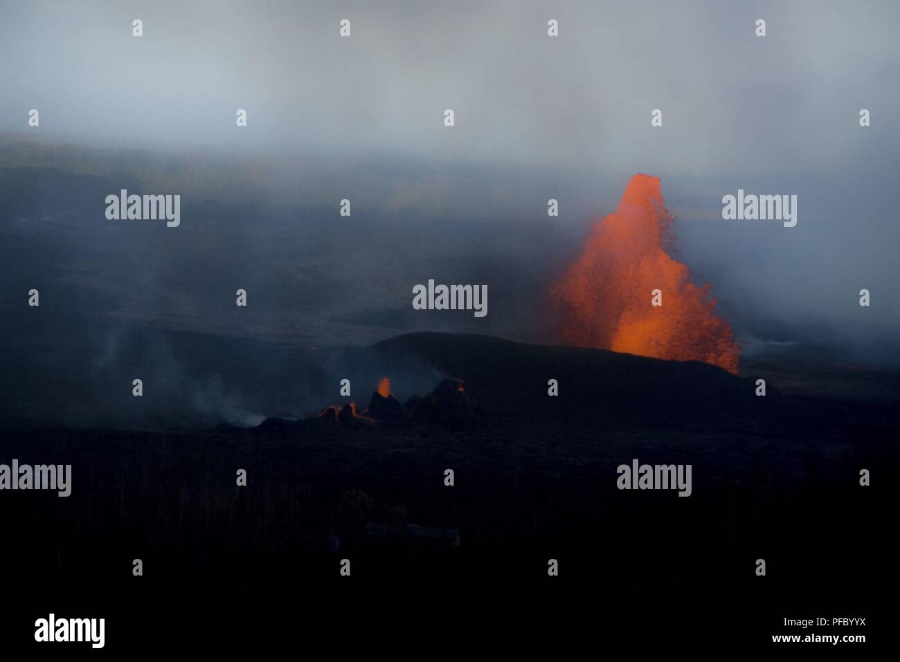 Leilani Estates, Hawaii, May 30, 2018 – Lava continues to fountain at Fissure 8, reaching heights of 130-210 feet. This activity is feeding a lava channel flowing east to the Kapoho Bay area and lava continues to enter the ocean around the Vacationland subdivision area. Volcanic gas emissions remain very high from the fissure eruptions. At the request of the state, FEMA staff are on the ground to support local officials with life-saving emergency protective measures, debris removal, and the repair, replacement, or restoration of disaster-damaged publicly-owned facilities. - Stock Image