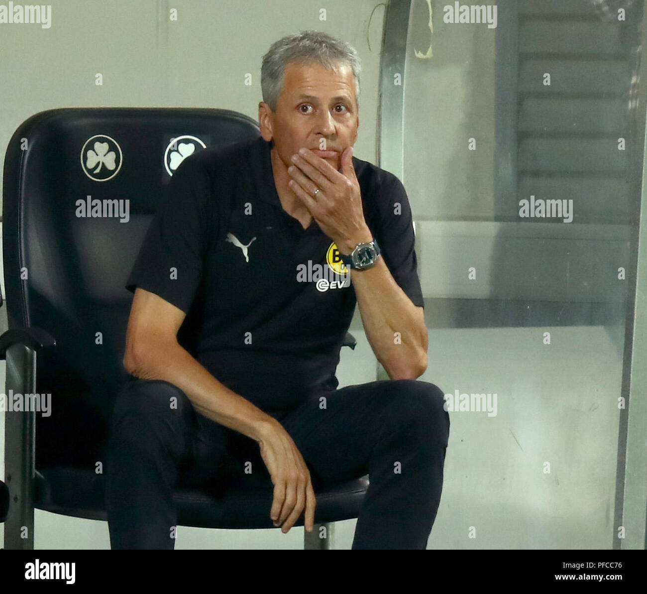 20.08.2018, Bavaria, Fürth: Football: DFB Cup, SpVgg Greuther Fürth - Borussia Dortmund, 1st round at Sportpark Ronhof Thomas Sommer. Dortmund coach Lucien Favre gestures on the sideline. (Important note: The DFB prohibits the use of sequence images on the Internet and in online media during the game (including half-time). vesting period! The DFB allows the publication and further use of the images on mobile devices (especially MMS) and via DVB-H and DMB only after the end of the game. Photo: Daniel Karmann/dpa - Stock Image