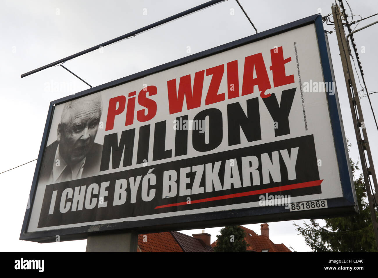 """Gdansk, Poland 20th Aug. 2018 Billboard with Jaroslaw Kaczynski face and slogan """" PiS (Law and Justice) took millions, and want to be unpunished """" is seen. Posters financed by the opposition parties displayed across the country refer to giant financial benefits of people connected with the government. Local elections in Poland are scheduled for October 21st. 2018 © Vadim Pacajev / Alamy Live News Stock Photo"""