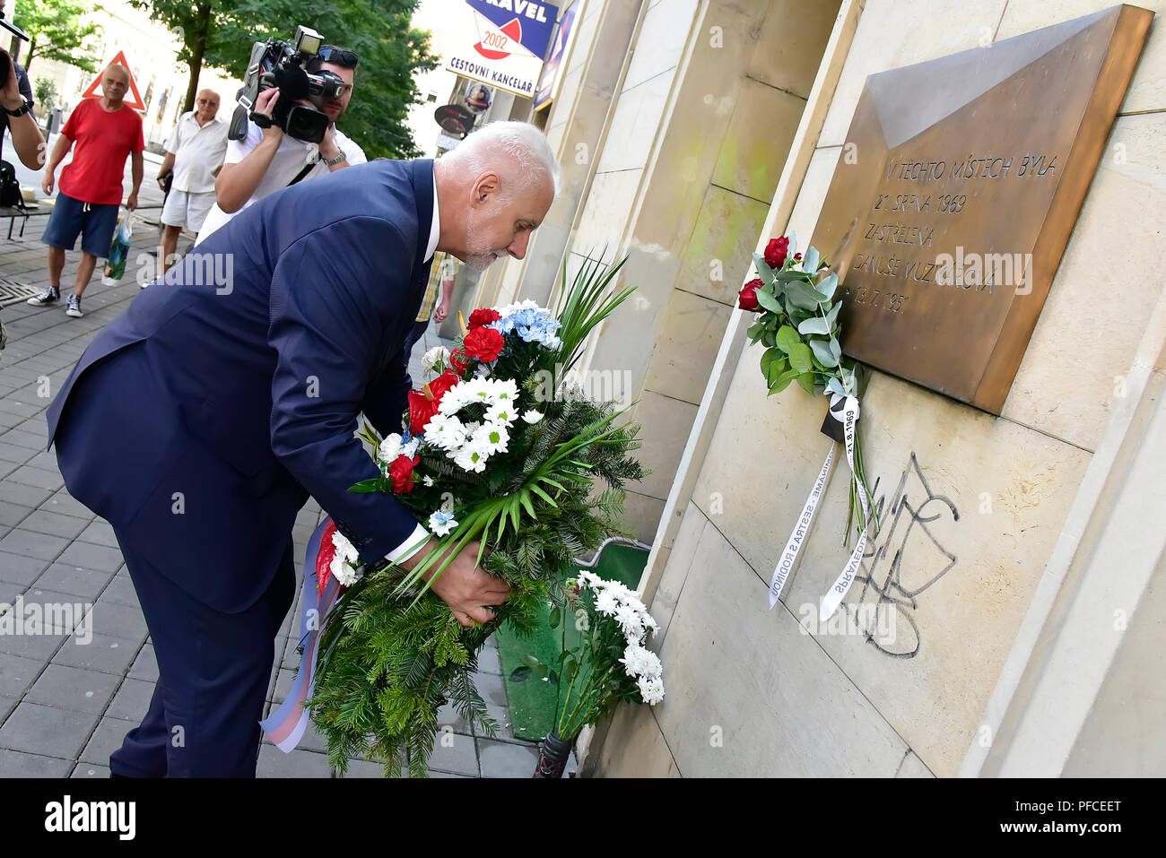 Brno, Czech Republic. 21st Aug, 2018. South Moravia Region Governor Bohumil Simek lays a wreath to commemorative plaque for Danuse Muzikarova, victim of Warsaw Pact invasion in August 1968, in Brno, Czech Republic, on August 21-018. Credit: Igor Sefr/CTK Photo/Alamy Live News Stock Photo