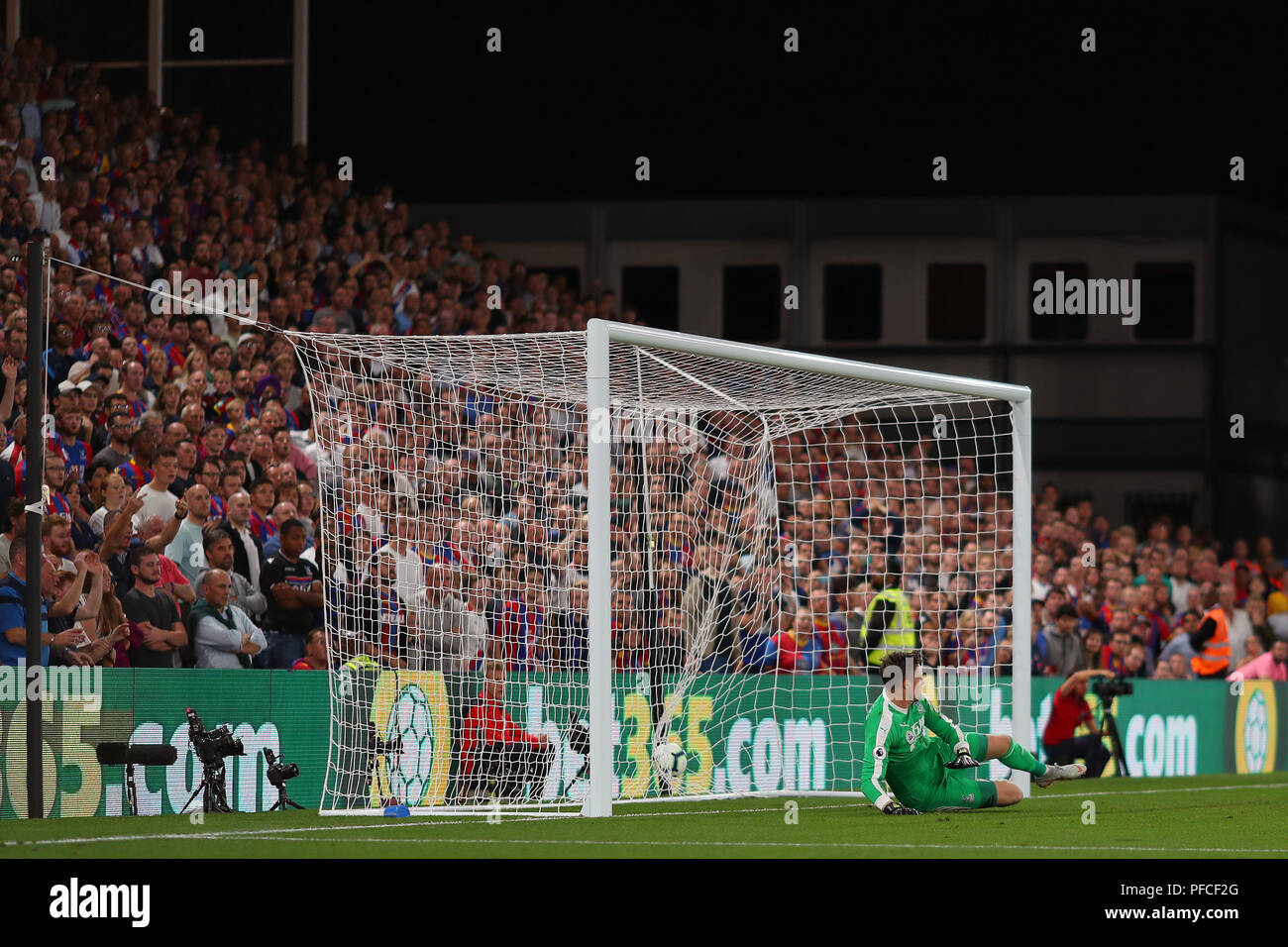 Crystal Palace fans watch on as Wayne Hennessey of Crystal Palace is beaten by a penalty from James Milner of Liverpool - Crystal Palace v Liverpool, Premier League, Selhurst Park, London (Selhurst) - 20th August 2018 Stock Photo