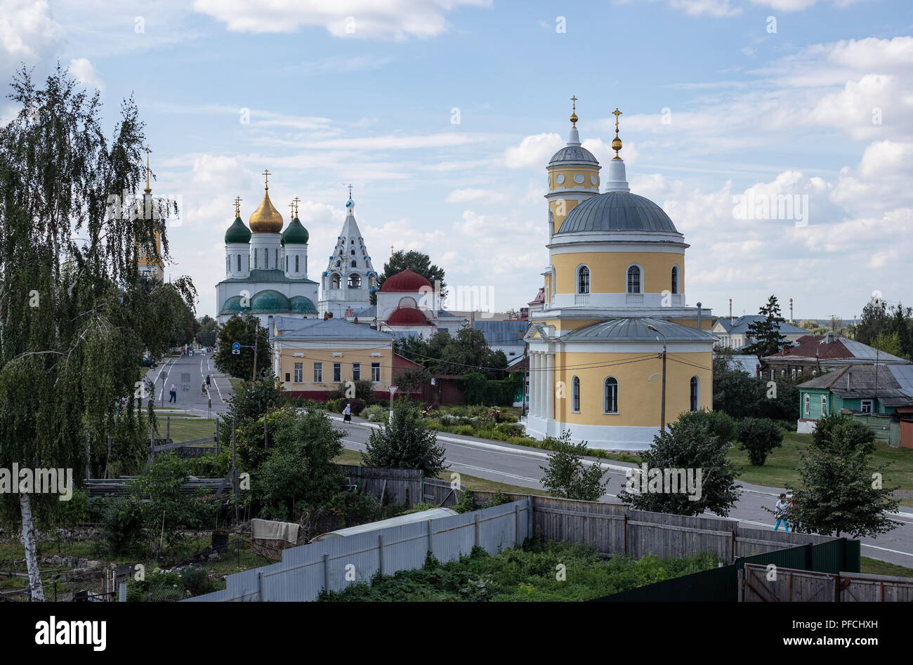 MOSCOW REGION, RUSSIA - AUGUST 20, 2018: A view of the Dormition Cathedral, a hipped-roof belfry of the Church of The Theotokos of Tikhvin, the Nikola Gostiny Church, and the Church of the Exaltation of the Holy Cross from a window of Suranov Soap Trade, a museum shop in the city of Kolomna, Moscow Region, based on an actual shop opened by merchant Grigory Suranov in the 1890s to sell products of a local soap factory. Stanislav Krasilnikov/TASS Stock Photo