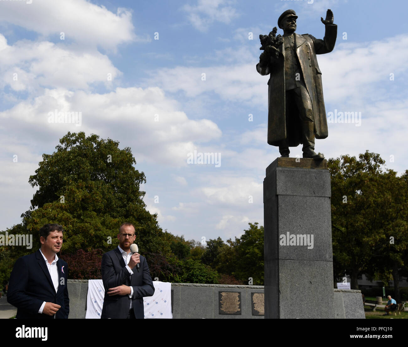 Prague, Czech Republic. 21st Aug, 2018. Unveiling of restored memorial to Soviet Marshal Konev with new plaques describing his life and work was held in Prague, Czech Republic, on August 21, 2018, day of the 50th anniversary of Warsaw Pact invasion in August 1968 to Czechoslovakia. On the photo speaks Ondrej Kolar, Mayor of Prague 6 and on the left side is seen his deputy Jan Lacina. Credit: Michal Krumphanzl/CTK Photo/Alamy Live News - Stock Image