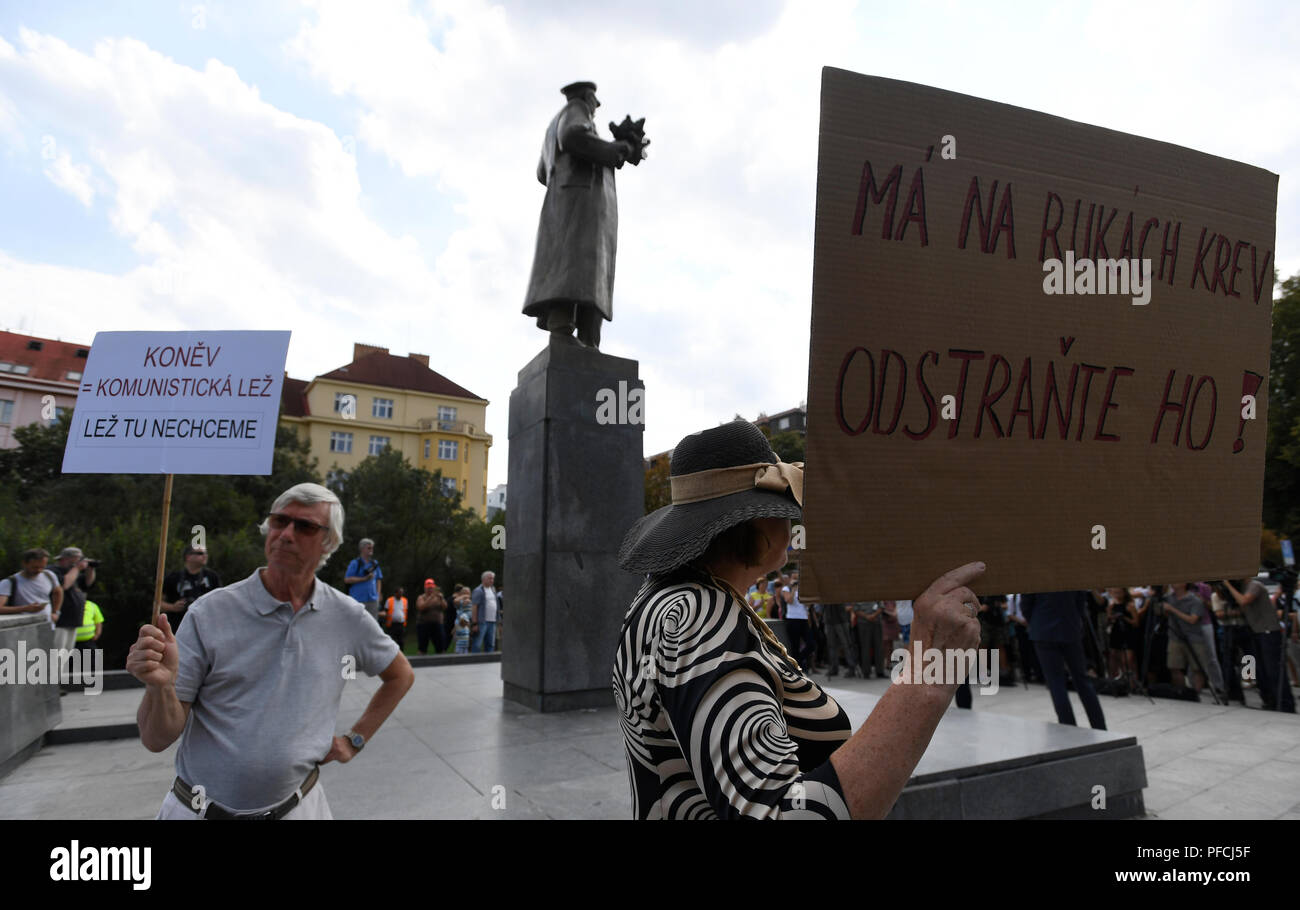 A several people protest after an unveiling of restored memorial to Soviet Marshal Konev with new plaques describing his life and work, in Prague, Czech Republic, on August 21, 2018, day of the 50th anniversary of Warsaw Pact invasion in August 1968 to Czechoslovakia. At the end of World War Two in May 1945, Konev (1897-1973) helped liberate Prague. There have been controversies over the statue due to Konev's participation in the suppression of the Hungarian uprising against the Communist regime in 1956 and the building of the Berlin Wall in 1961. (CTK Photo/Michal Krumphanzl) Stock Photo