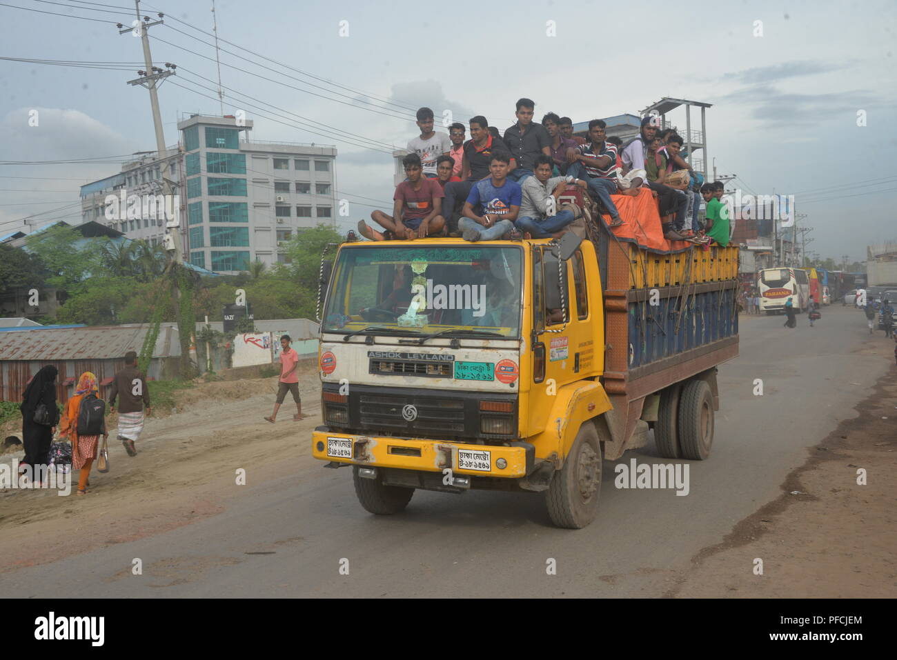 Dhaka. 21st Aug, 2018. Homebound travelers travel on a truck in Dhaka, Bangladesh, on Aug. 20, 2018, during the Eid al-Adha festival. Credit: Xinhua/Alamy Live News - Stock Image
